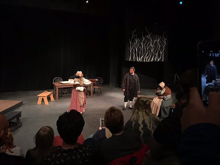 Photo of The Crucible play with audience in foreground