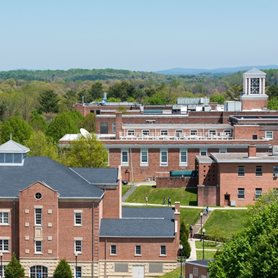 This is a photo of the outside of campus with the Rahall Technology Building in the foreground.