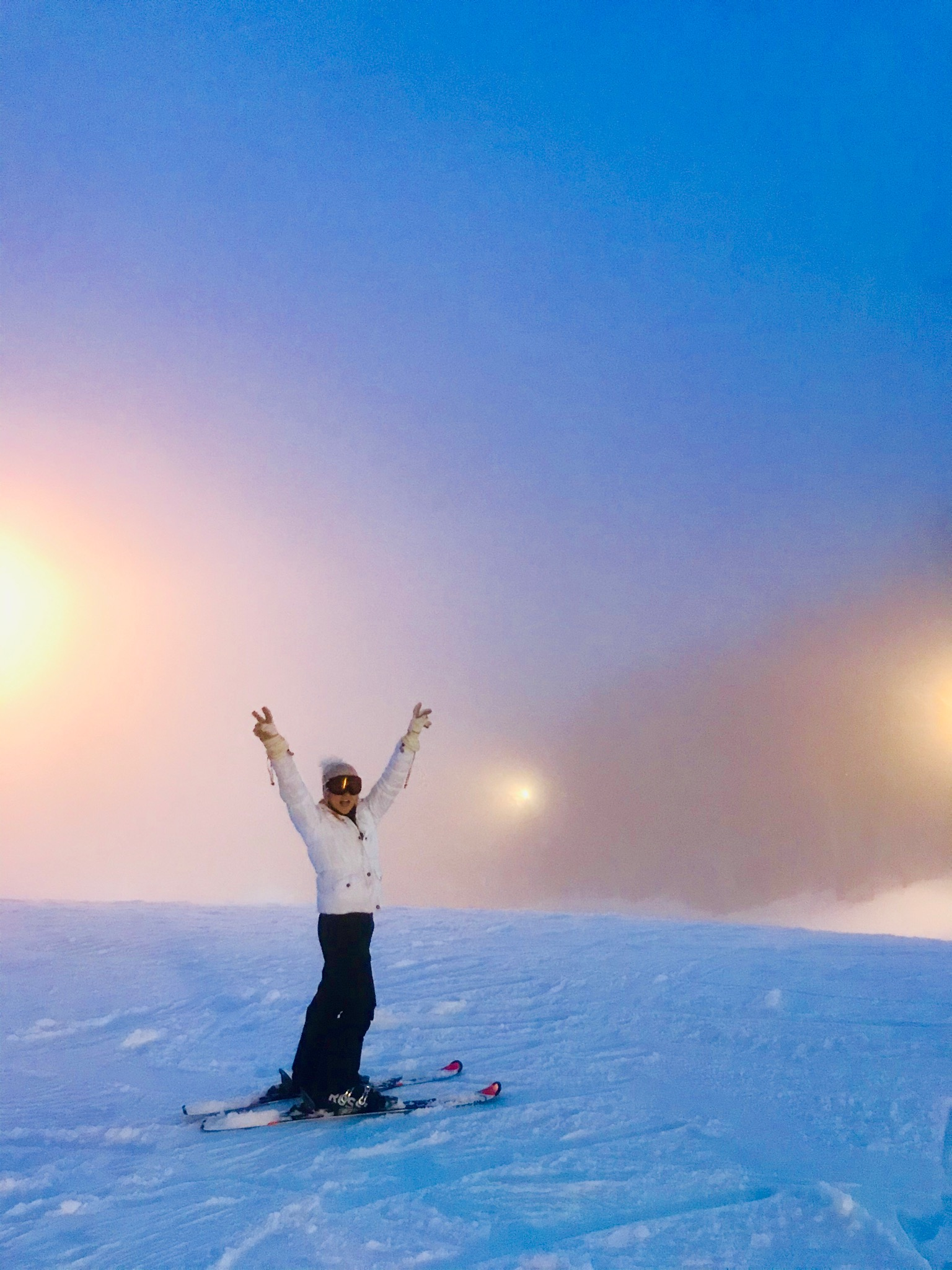 A young woman posing at the top of one of Winterplace's Skiing hills.